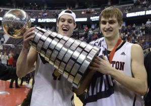 Ravens Kevin Churchill (left) & Tyson Hinz hoist their 4th championship trophy credit: Justin Tang, The Canadian Press