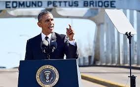 President Obama speaking at the Edmund Pettus Bridge (credit: Bill Frakes/AP)